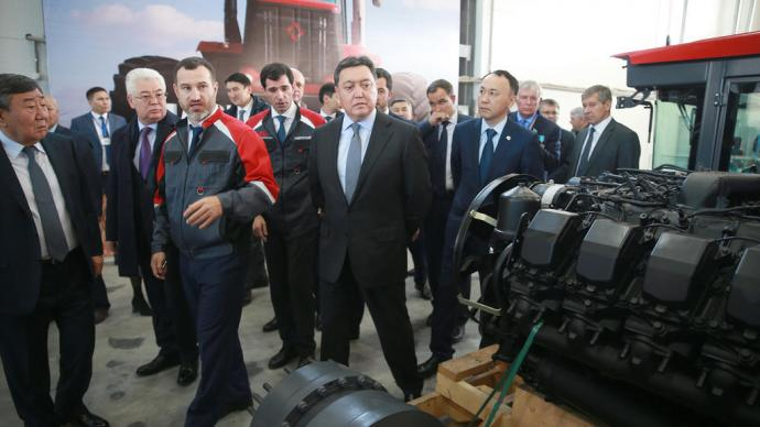 Prime Minister Askar Mamin tests first Kirovets tractor manufactured in Kazakhstan